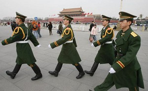 Large numbers of armed policemen patrol Tiananmen Square during conference session, March 8, 2006.