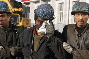 Chinese miners assist an injured coworker after an underground gas explosion. (China Photos/Getty Images)