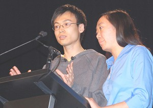 Li Dan and an interpreter at the prize-giving ceremony. (The Epoch Times)