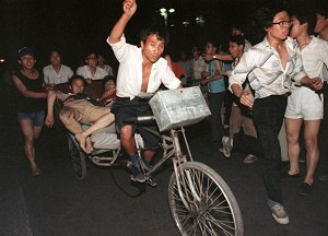 Two injured during the clash between the army and students, June 4, 1989 near Tiananmen Square are carried out by a cart.  (Manuel Ceneta/AFP/Getty Images)