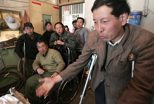 A group of people living in Dongshan coalmine hospital near Taiyuan city, Shanxi province, crippled by coalmine accidents. (AFP/Getty Images, photo on March 22, 2006)