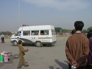 Petitioners protesting on Tiananmen Square were thrown into police vans and taken away on May 2, 2006. (The Epoch Times)