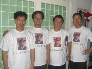 """Zhao Xin, Li Hai, Hu Jia, Liu Jingsheng and Qi Zhiyong—a human rights activist who was handicapped during the 1989 Tiananmen Massacre—wear T-shirts with Mr. Chen's picture and the words """"Rescue Chen Guangcheng."""" (The Epoch Times)"""