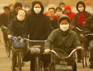 Cyclists brave a sandstorm in the northeastern Chinese city of Shenyang.   (AFP/Getty Images)