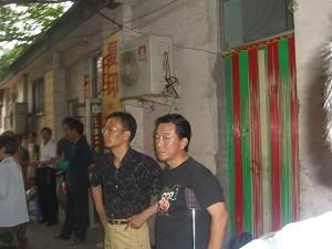 Qi Zhiyong and Jiao Guobiao from Ark Church. (The Epoch Times)