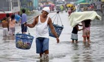 Kaemi Weakens into Tropical Storm over South China