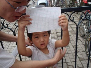 """Li Xige's daughter crying, """"Free my mother!"""" (Hu Jia, a Beijing-based AIDS activist)"""