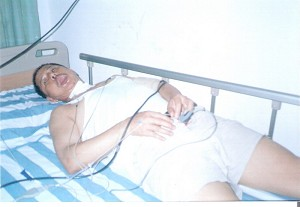 Photo of village representative Huang Shuming who was brutally beaten. His face was swollen, his head felt giddy and his groin was red and swollen. (The Epoch Times)