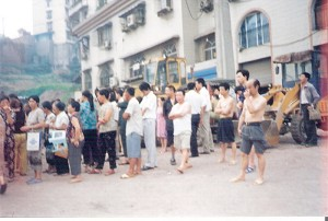 Villagers and observers standing outside the security line (June 28). (The Epoch Times)
