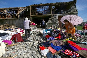 People salvage personal posessions from house damaged by the typhoon (China Photos/Getty Images)