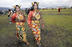 Young Tibetan women dressed in traditional costumes at a festival in Litang County. (Liu Jin/AFP/Getty Images)