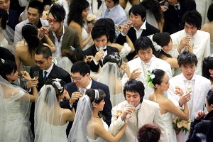 Newlyweds drink from the nuptial cup at a marriage ceremony in Beijing. (STR/AFP/Getty Images)