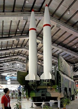 A man looks at a Chinese-made P12 Missile Weapon System at a China International Aviation and Aerospace Exhibition in Zhuhai. (Ted Aljibe/AFP/Getty Images)