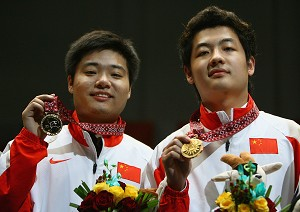 Ding Junhui (L) and Tian Pengfei (R) of China pose with their Gold Medals at the 15th Asian Games Doha 2006 at Al Sadd Sports Complex.  (Ryan Pierse/Getty Images for DAGOC)