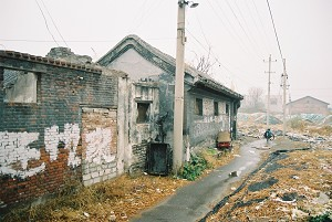Liu's neighbour's house. Most of the houses have been demolished, leaving behind a vast open area of land.  (Yodo Soma)