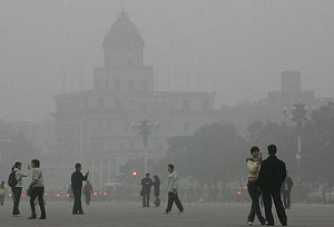 People walk around Tiananmen Square shrouded with smog, Beijing, China. (China Photos/Getty Images)