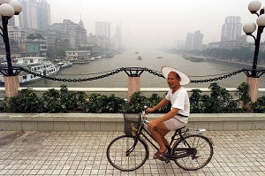 A man cycles on a bridge over the Pearl River in Guangzhou. (Peter Parks/AFP/Getty Images)