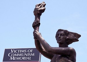 The Victims of Communism Memorial in Washington, D.C. stands behind a replica of the Goddess of Democracy statue erected by protesters in Tiananmen Square in 1989. Chinese dissident groups around the world are betting on an impending regime change in mainland China, and they intend to be ready whenever it comes. (Karen Bleier/AFP/Getty Images)