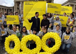 Chinese human rights lawyer Biao Teng gestures during a demonstration by activists from the German chapter of Amnesty International in Berlin December 7, 2007. Amnesty International accused China of reneging on promises to improve the human rights situation in the country before hosting the 2008 Olympic Games. Placard reads: 'We demand gold for human rights activists.' (Marcus Brandt/AFP/Getty Images)