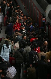 Train travelers form long lines in Beijing around the Chinese New Years. (Getty Images)