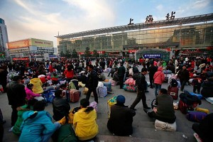 Passengers waiting outside a train station in Shanghai. (Getty Images)