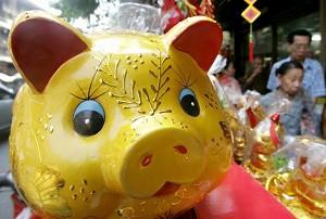 Bangkok, Thailand-A mascot of a pig prior to Lunar New Year celebrations (Pornchai Kittiwongsakul/ AFP)