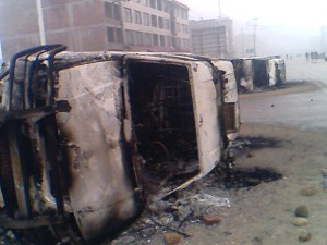 Burned police vehicles after the riot. (Pan-Blue Coalition