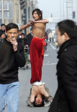 Boys giving a performance. (Goh Chai Hin/AFP/Getty Images)