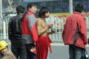 """Boys performing """"throat-locking"""" with a metal chain. (Goh Chai Hin/AFP/Getty Images)"""