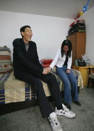 Shy newlyweds Bao Xishun and Xia Xishun hold hands. (China Photos/Getty Images)