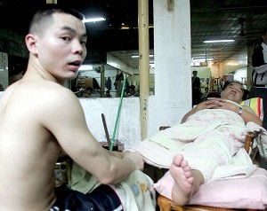 A man gets a traditional foot massage at an old bathhouse in Fuzhou, southeastern China's Fujian province. (AFP/AFP/Getty Images)