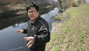 Environmental activist Wu Lihong, looks at a polluted and blackened canal next to a vegetable field, outside a factory in Yixing town in Jiangsu province, last year.  (Mark  Ralston/AFP/Getty Images)