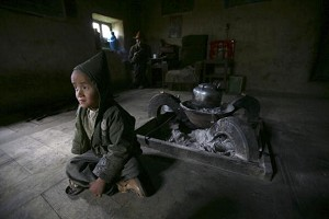 A Tibetan boy at home with Grandpa (Getty Images)
