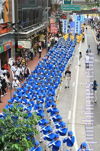 200 members strong, the Divine Land Marching Band took up an entire city block. (Li Ming/The Epoch Times)