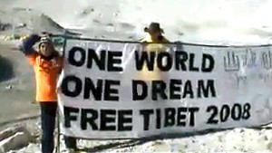 """Three Tibetan independence activists erect a banner that reads """"One World, One Dream, Free Tibet 2008,"""" at a Mount Everest base camp in Tibet after protesting against China's plan to take the Olympic torch to the top of the mountain. (AFP/Getty Images)"""