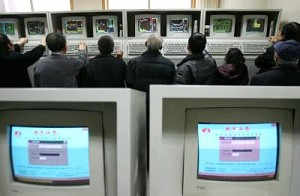 Investors view the stock index on computer monitors at a securities company on March 1, 2007 in Beijing, China. White-collar workers in China speculating in stocks during work hours is common. (China Photos/Getty Images)
