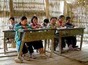 Children sit at makeshift desks. (Ben Ben)