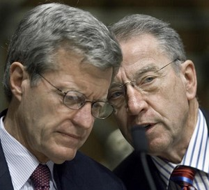 Committee Chairman and Senator Charles Grassley (R) speaks with Sen. Max Baucus as U.S. government trade about U.S. policies on trade with China. (Paul J.Richards/AFP/Getty Images)