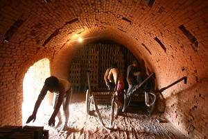 Many children and handicapped persons are kidnapped and sold to underground brick factories in Shanxi and Henan Provinces. They are forced to work 14 to 16 hours a day. The picture shows a brick factory in Mou County in Henan Province. (Epoch Times Archive)