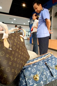 Counterfeit Louis Vuitton handbags displayed at the Beijing Administration for Industry and Commerce. (AFP/Getty Images)