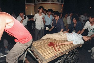 A girl wounded during the clash between the army and students June 4, 1989 near Tiananmen Square is carried out by rickshaw driver. (Manuel Ceneta/AFP/Getty Images)