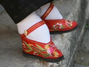 Tiny bound feet in embroidered lotus shoes (Getty Images)