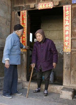 An elderly woman with bound feet heads out for a walk. (Getty Images)