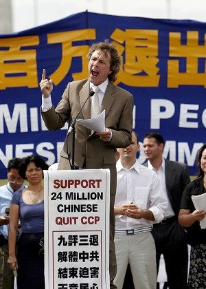 "Timothy Cooper, Executive director of Worldrights, a non-profit human rights organization, speaks out against the crimes of the Chinese Communist Regime. The ""Quit the CCP"" rally was held in front of the Washington Momument on Friday, July 20th. (Dayin Chen/The Epoch Times)"
