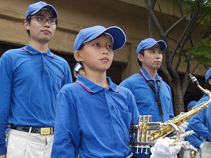 Siang, is an eight-year-old trumpet player in the Celestial Band formed by Taiwan Falun Gong practitioners. (By Tang Bin / the Epoch Times)