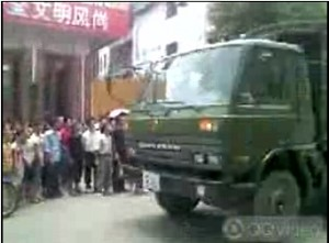 A military vehicle arrives to disperse the crowd. (The Epoch Times)