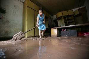 On July 29, 2007, Chongqiong City suffered its worst downpour in a century. Millions of people were affected, with nearly 100 dead or missing. The economic loss hit 2.978 billion yuan ($0.39 billion). (Getty Images/China Photos)