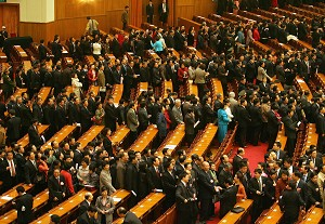 National People's Congress (NPC) delegates leave the Great Hall of the People in Beijing following the closing session of China's annual rubber-stamp parliament, 16 March 2007. (Frederic J. Brown/AFP/Getty Images)