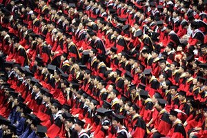 Students graduate during a ceremony at the Tsinghua University on July 18, 2007 in Beijing, China. Beijing police has introduced a plan to station in major universities. (China Photos/Getty Images)