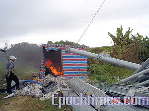 The villagers burned one of the gangsters' tents. (The Epoch Times)